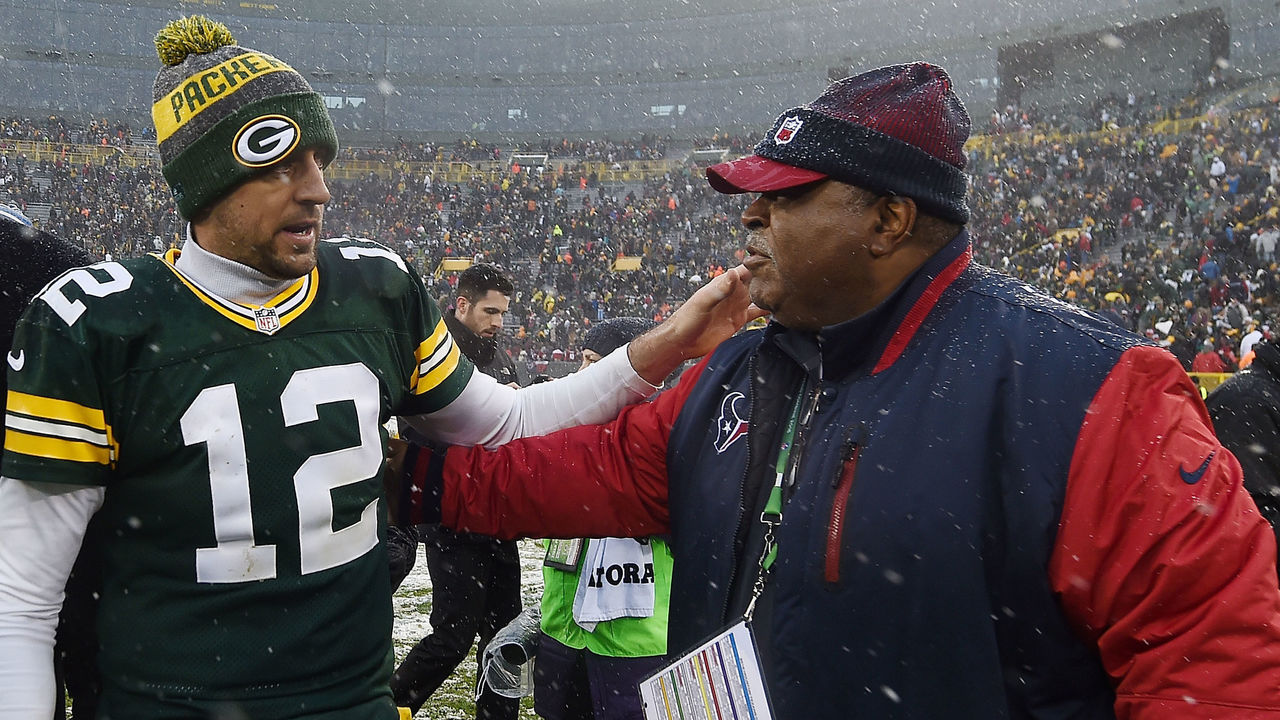 GREEN BAY, WI - DECEMBER 04: Aaron Rodgers #12 of the Green Bay Packers greets defensive coordinator Romeo Crennel of the Houston Texans following a game at Lambeau Field on December 4, 2016 in Green Bay, Wisconsin. Green Bay defeated Houston 21-13.