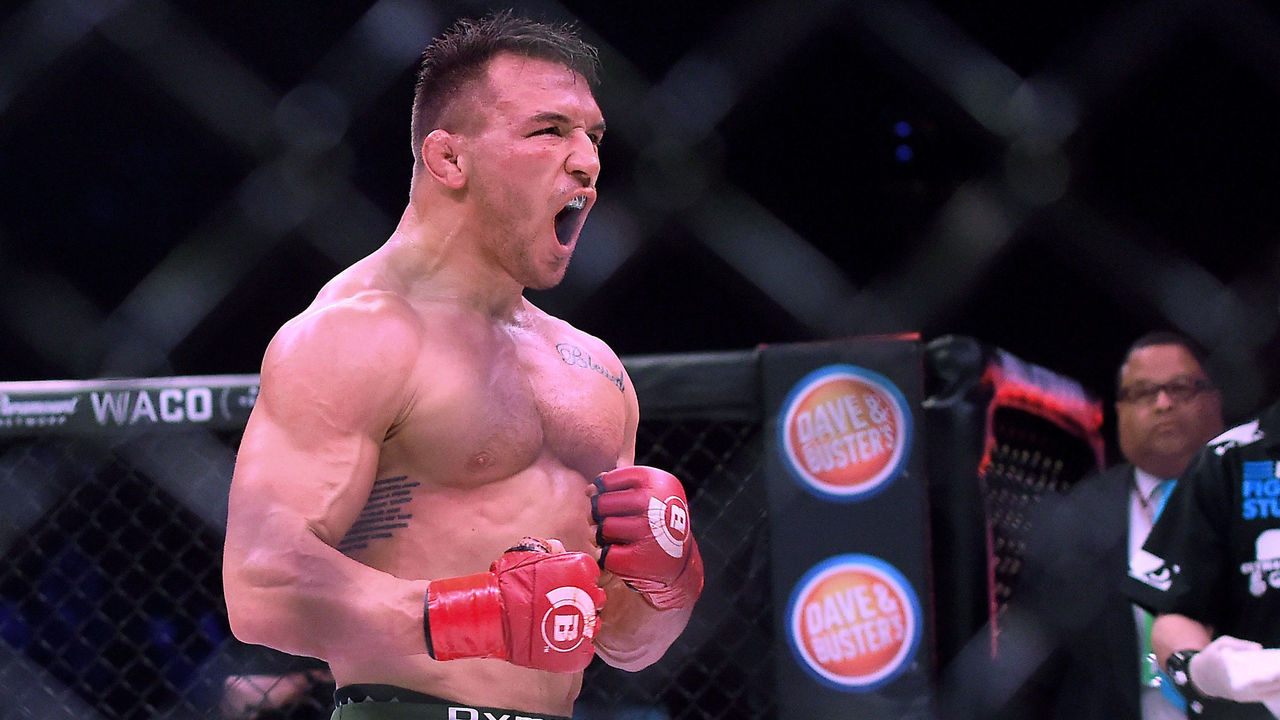 INGLEWOOD, CA - JANUARY 20: Michael Chandler Jr (red gloves) celebrates after defeating Goiti Yamauchi (blue gloves) in their Lightweight fight at Bellator 192 at The Forum on January 20, 2018 in Inglewood, California. Michael Chandler Jr won by unanimous decision.