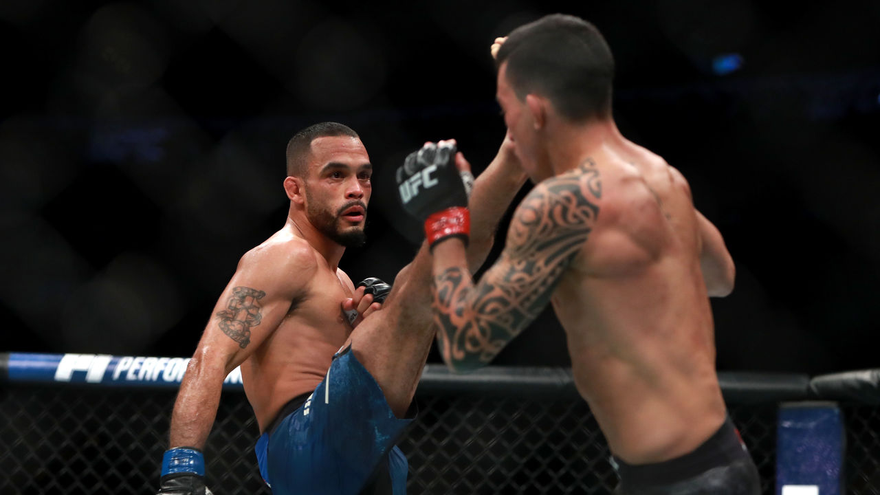 BOSTON, MA - JANUARY 20: Rob Font kicks against Thomas Almeida in their Bantamweight fight during UFC 220 at TD Garden on January 20, 2018 in Boston, Massachusetts.
