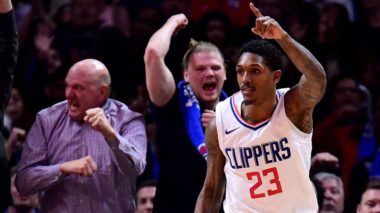LOS ANGELES, CA - DECEMBER 20: Lou Williams #23 of the LA Clippers celebrates his last second dunk to end the third quarter against the Phoenix Suns during a 108-95 Clipper win at Staples Center on December 20, 2017 in Los Angeles, California.
