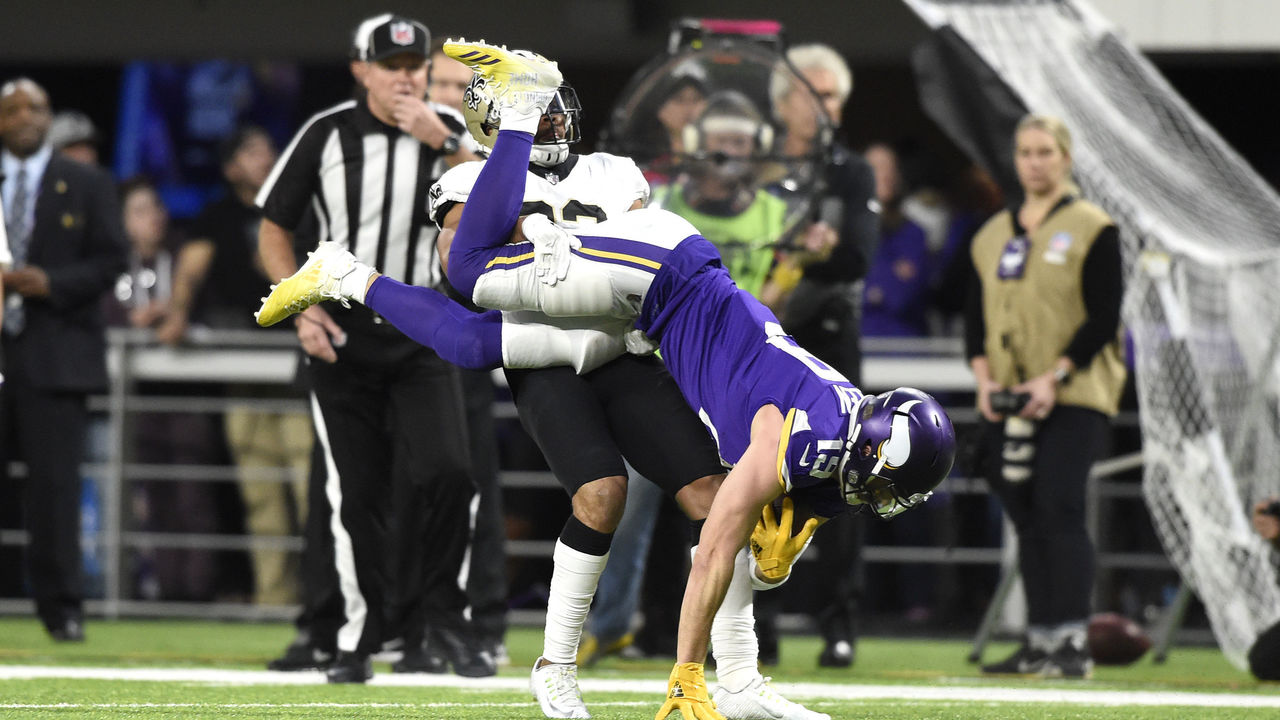 MINNEAPOLIS, MN - JANUARY 14: Adam Thielen #19 of the Minnesota Vikings is flipped upside down after catching the ball in the first half of the NFC Divisional Playoff game against the New Orleans Saints on January 14, 2018 at U.S. Bank Stadium in Minneapolis, Minnesota.