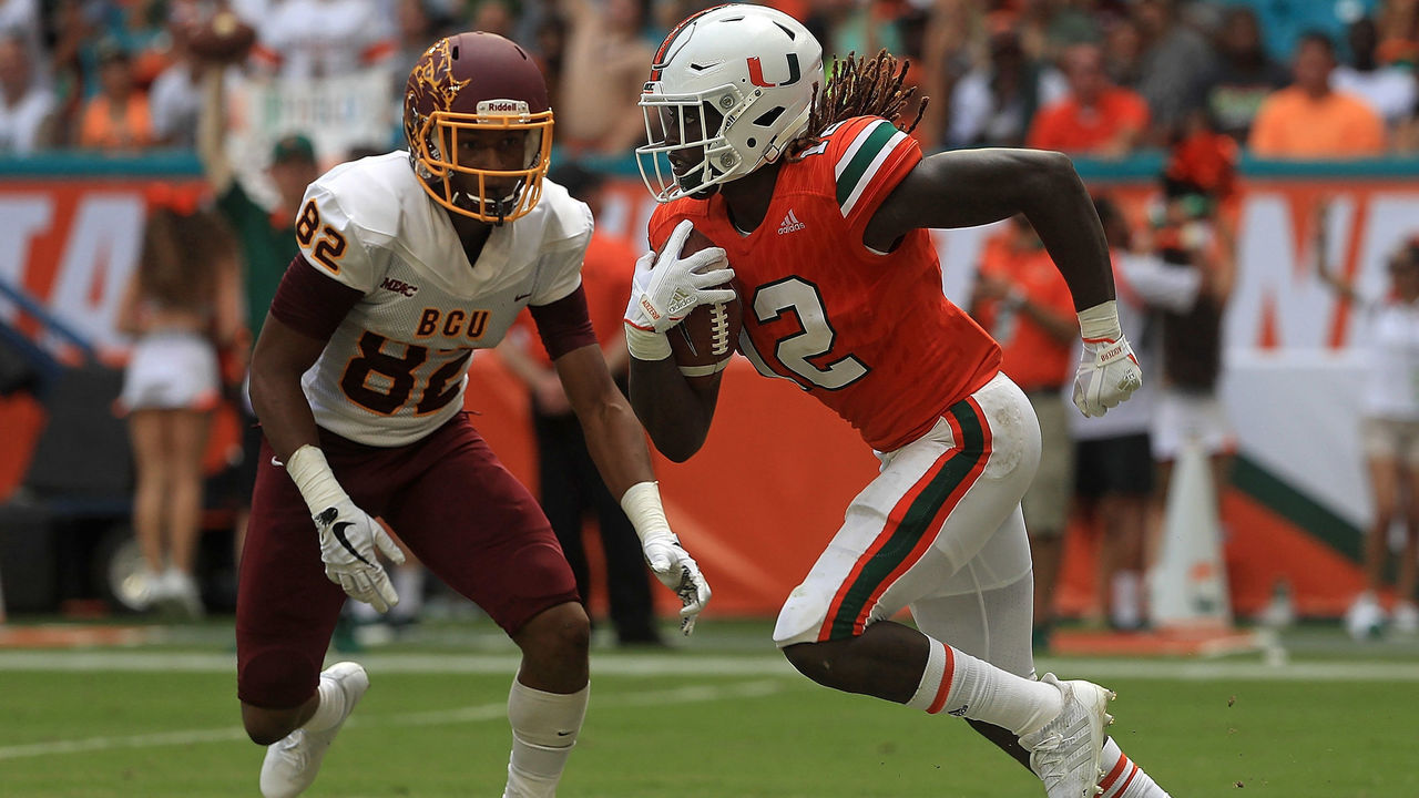 MIAMI GARDENS, FL - SEPTEMBER 02: Malek Young #12 of the Miami Hurricanes returns an interception during a game against the Bethune Cookman Wildcats at Hard Rock Stadium on September 2, 2017 in Miami Gardens, Florida.