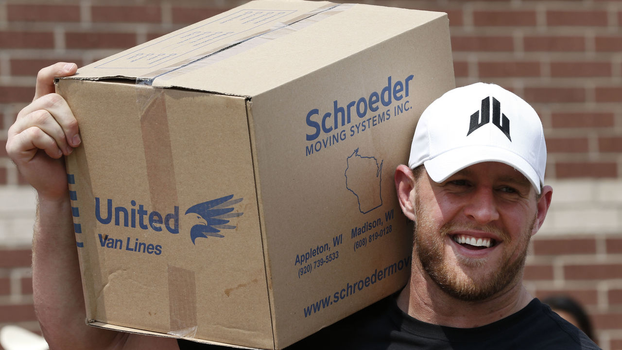 HOUSTON, TX - SEPTEMBER 3: (AFP OUT) Houston Texans defensive end J.J. Watt holds a box of relief supplies on his shoulder while handing them out to people impacted by Hurricane Harvey on September 3, 2017, in Houston, Texas. Watt's Hurricane Harvey Relief Fund has raised more than $18 million to date to help those affected by the storm.