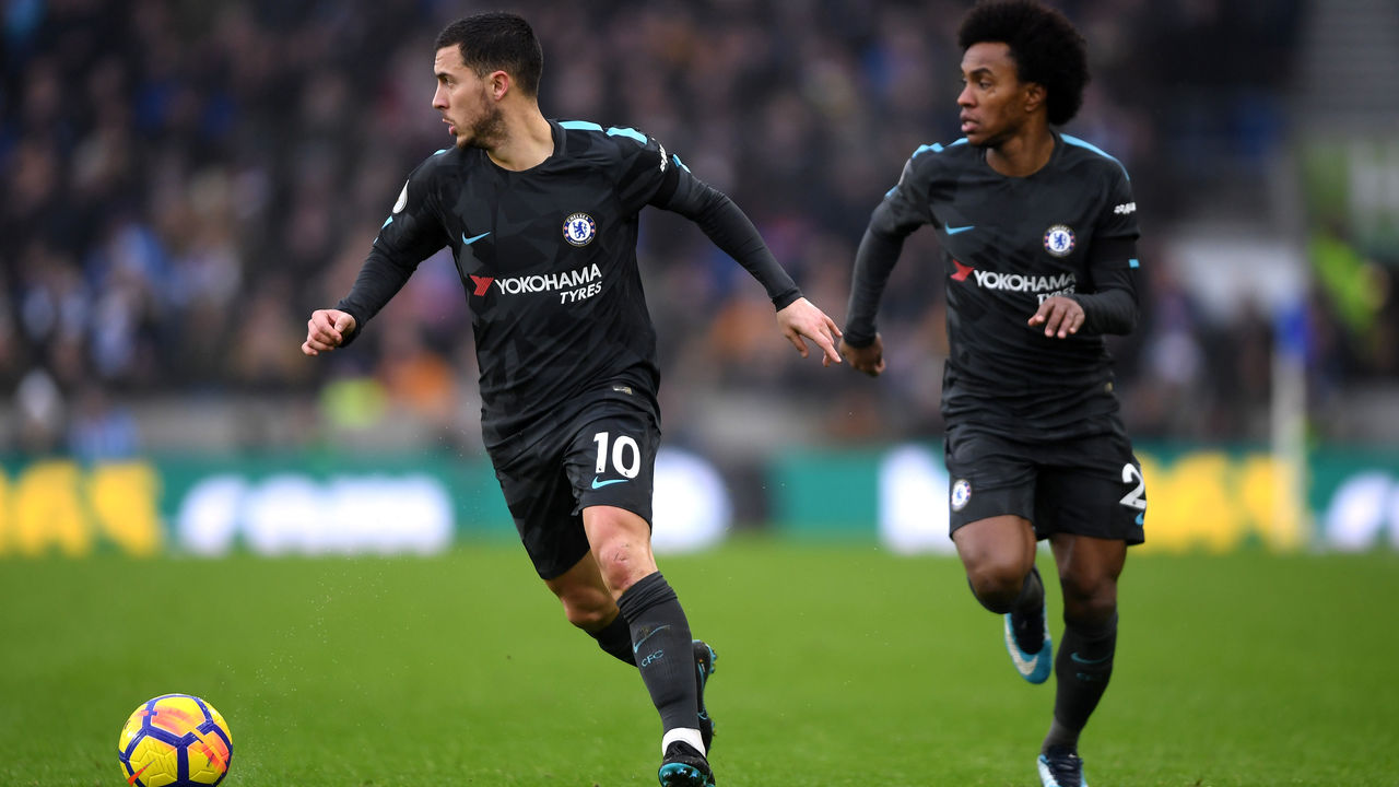 BRIGHTON, ENGLAND - JANUARY 20: Eden Hazard of Chelsea runs with the ball during the Premier League match between Brighton and Hove Albion and Chelsea at Amex Stadium on January 20, 2018 in Brighton, England.