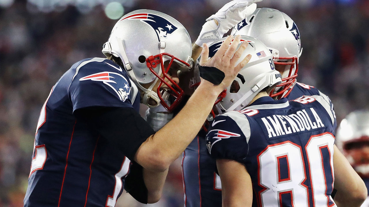 FOXBOROUGH, MA - JANUARY 21: Tom Brady #12 of the New England Patriots celebrates a touchdown with Danny Amendola #80 in the fourth quarter during the AFC Championship Game against the Jacksonville Jaguars at Gillette Stadium on January 21, 2018 in Foxborough, Massachusetts.
