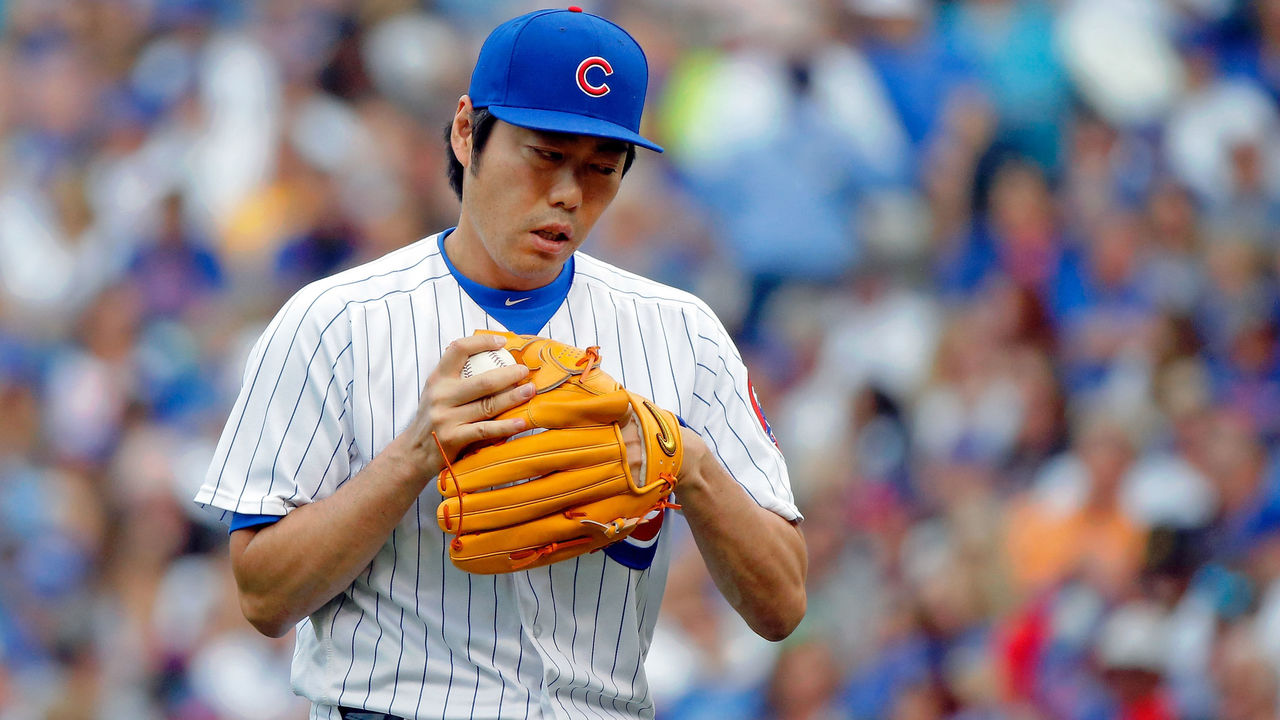 CHICAGO, IL - SEPTEMBER 02: Koji Uehara #19 of the Chicago Cubs between pitches during the seventh inning against the Atlanta Braves at Wrigley Field on September 2, 2017 in Chicago, Illinois.