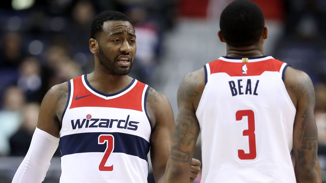 WASHINGTON, DC - DECEMBER 13: John Wall #2 and Bradley Beal #3 of the Washington Wizards talk during the second half against the Memphis Grizzlies at Capital One Arena on December 13, 2017 in Washington, DC.