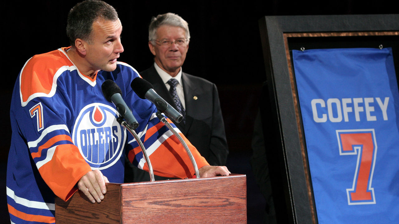 EDMONTON, CANADA - OCTOBER 18: Edmonton Oilers Governor Cal Nichols (R) looks on as Oilers great Paul Coffey delivers a speech before his number 7 retirement banner is raised to the rafters during a special ceremony on October 18, 2005 at Rexall Place in Edmonton, Alberta, Canada.