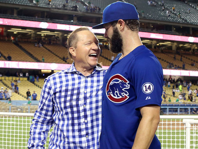 LOS ANGELES, CA - AUGUST 30: Starting pitcher Jake Arrieta #49 of the Chicago Cubsis greeted by agent Scott Boras after pitching a no hitter against the Los Angeles Dodgers at Dodger Stadium on August 30, 2015 in Los Angeles, California. The Cubs won 2-0.