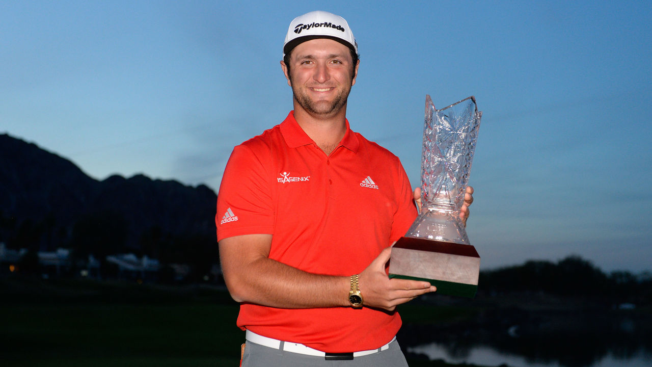 LA QUINTA, CA - JANUARY 21: Jon Rahm of Spain poses with the trophy after putting in to win on the fourth hole of a sudden death playoff during the final round of the CareerBuilder Challenge at the TPC Stadium Course at PGA West on January 21, 2018 in La Quinta, California.