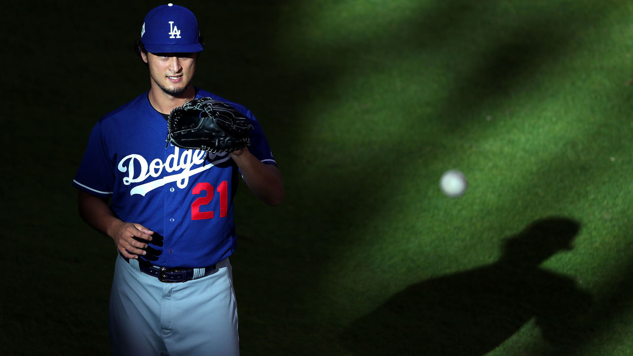 HOUSTON, TX - OCTOBER 29: Yu Darvish #21 of the Los Angeles Dodgers warms up before game five of the 2017 World Series against the Houston Astros at Minute Maid Park on October 29, 2017 in Houston, Texas.