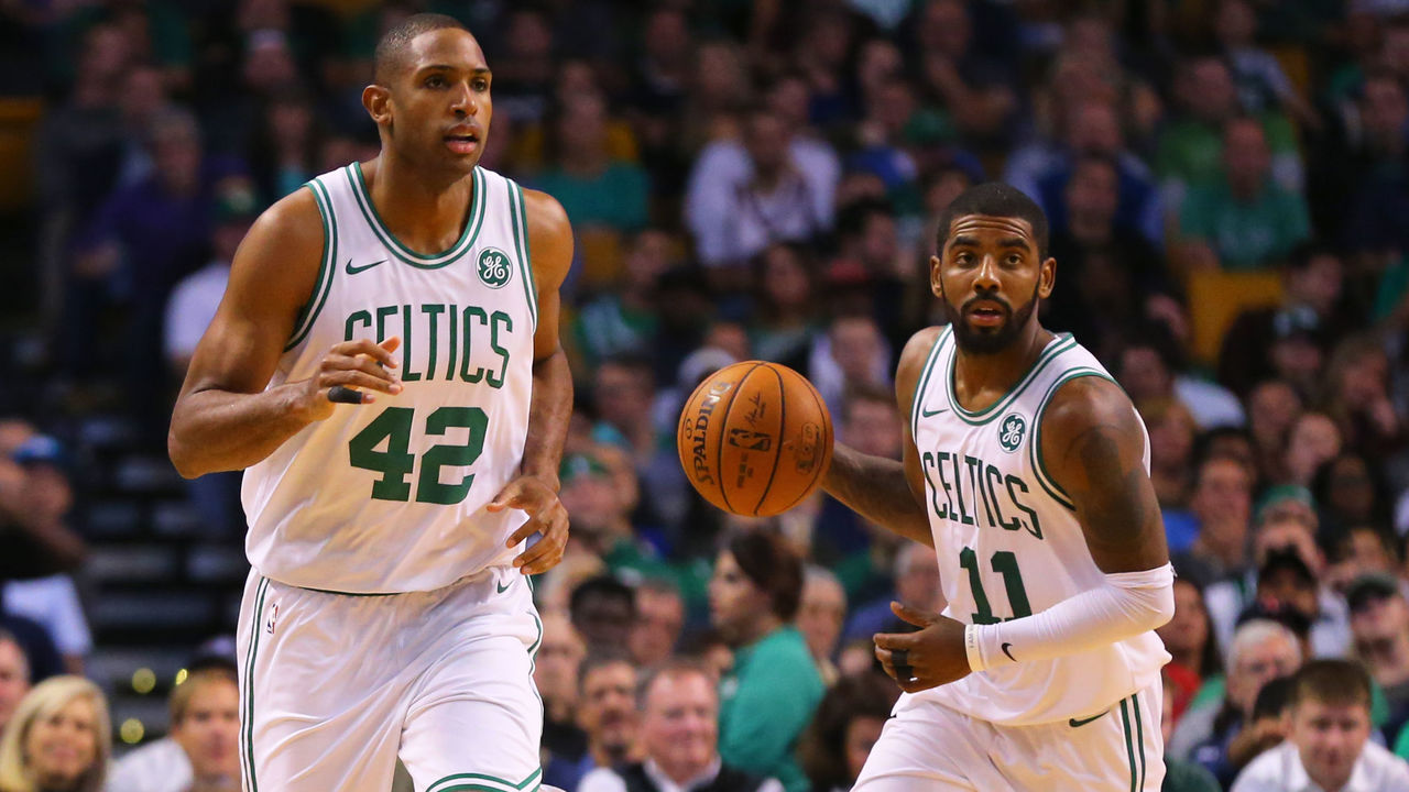 BOSTON, MA - OCTOBER 24: Kyrie Irving #11 of the Boston Celtics dribbles past Al Horford #42 during the first half against the New York Knicks at TD Garden on October 24, 2017 in Boston, Massachusetts.