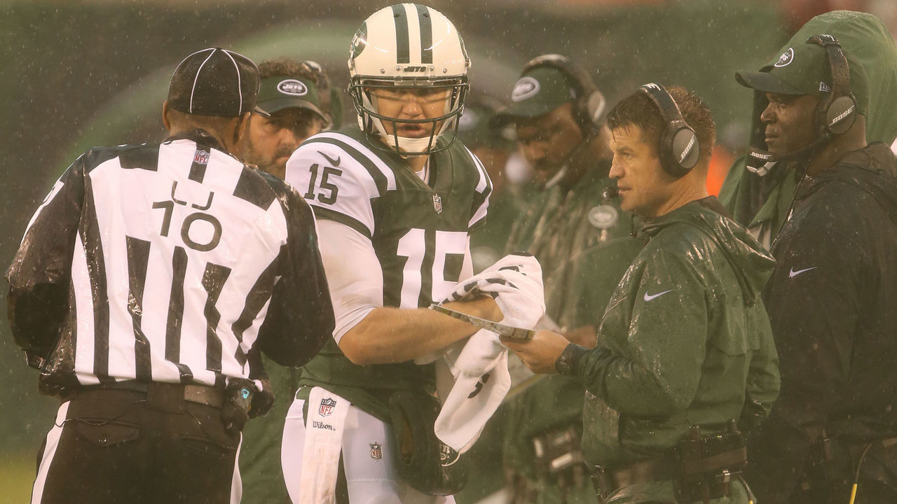 EAST RUTHERFORD, NJ - OCTOBER 29: Quarterback Josh McCown #15 and Quarterbacks Coach Jeremy Bates of the New York Jets in action against the Atlanta Falcons in a heavy rain storm during their game at MetLife Stadium on October 29, 2017 in East Rutherford, New Jersey.