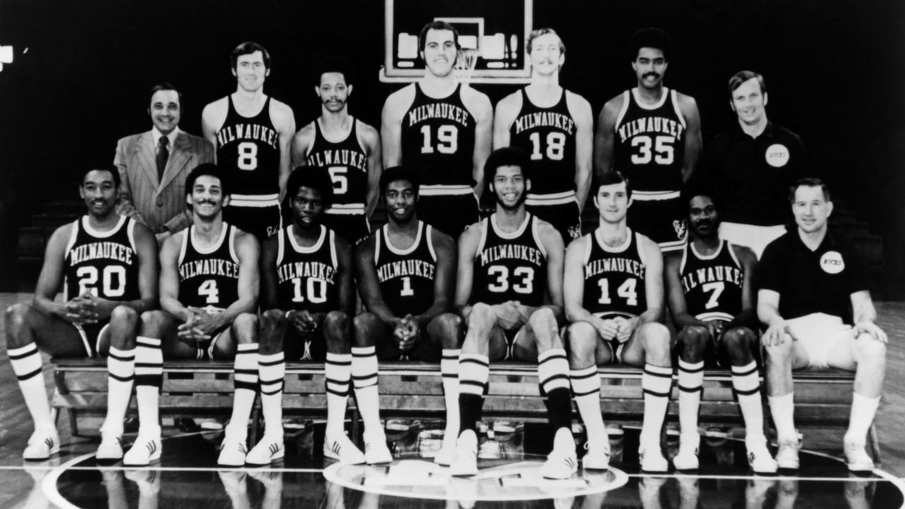 MILWAUKEE, WI - 1971: The 1970-71 NBA Champion Milwaukee Bucks pose for a team portrait in Milwaukee, Wisconsin. Seated from left, Bob Boozer, Greg Smith, Bob Dandridge, Oscar Robertson, Kareem Abdul Jabbar, John McGlocklin, Lucius Allen and Coach Larry Costello. Standing: Trainer Arnie Garber, Jeff Webb, Marvin Winkler, Dick Cunningham, Bob Greacen, McCoy McLemore, Assistant Coach Tom Nissalke. NOTE TO USER: User expressly acknowledges and agrees that, by downloading and or using this photograph, User is consenting to the terms and conditions of the Getty Images License Agreement. Mandatory copyright notice: Copyright NBAE 2002