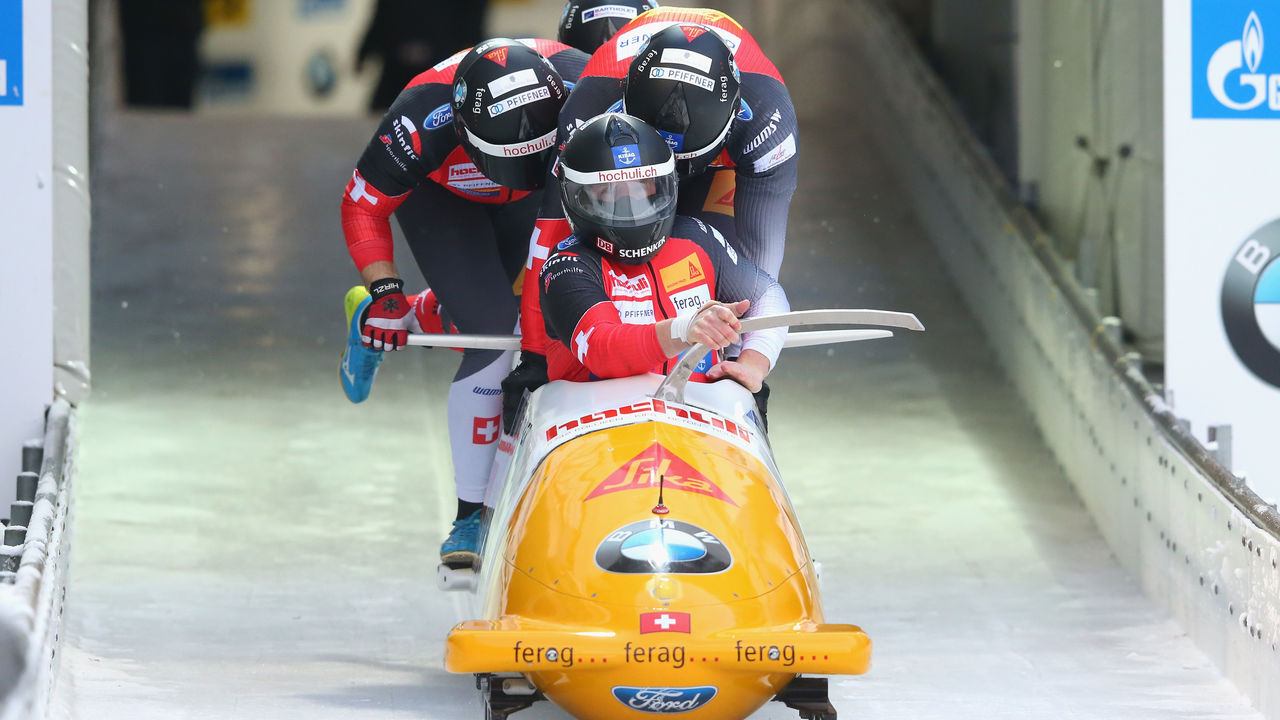 KOENIGSSEE, GERMANY - JANUARY 21: Rico Peter of Switzerland competes with Alex Baumann, Simon Friedli and Michael Kuonen at Deutsche Post Eisarena Koenigssee during the BMW IBSF World Cup 4-man Bobsleigh on January 19, 2018 in Koenigssee, Germany.
