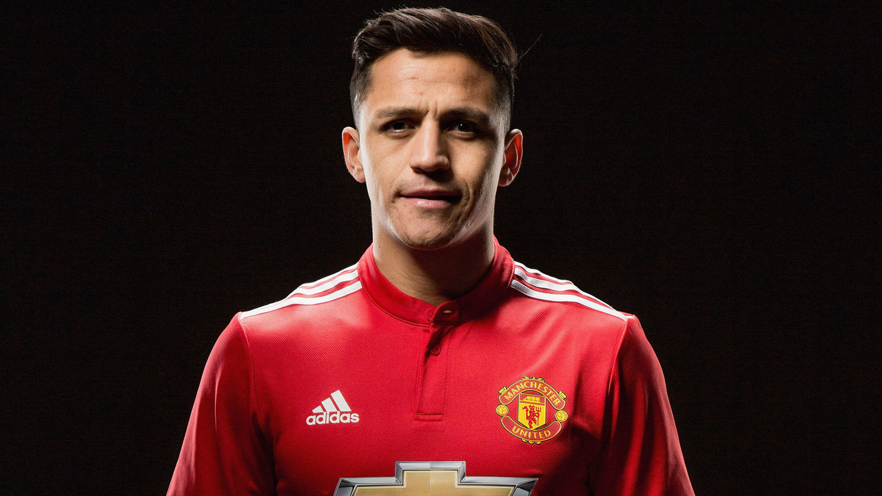 MANCHESTER, ENGLAND - JANUARY 22: (EXCLUSIVE COVERAGE) Alexis Sanchez of Manchester United poses after signing for the club at Old Trafford on January 22, 2018 in Manchester, England.