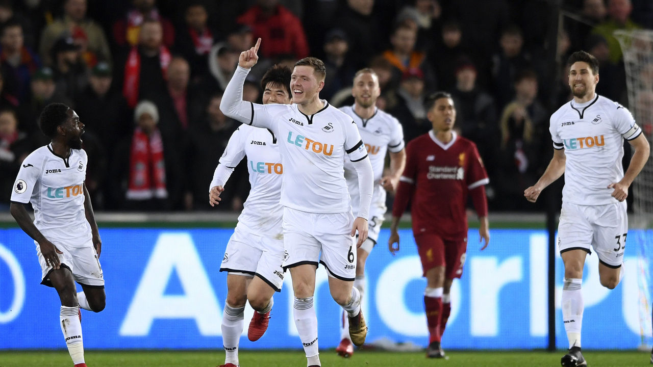SWANSEA, WALES - JANUARY 22: Alfie Mawson of Swansea City celebrates scoring his side's first goal during the Premier League match between Swansea City and Liverpool at Liberty Stadium on January 22, 2018 in Swansea, Wales.