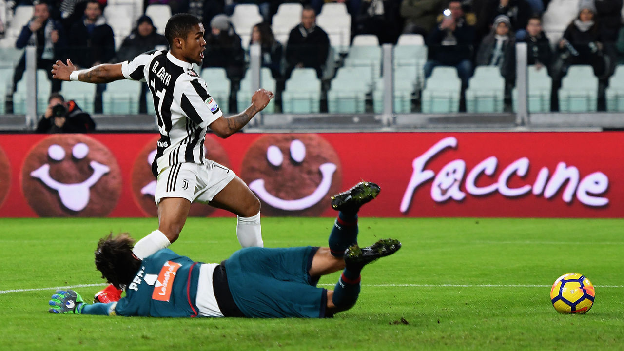 TURIN, ITALY - JANUARY 22: De Suoza Douglas Costa of Juventus scores the opening goal during the Serie A match between Juventus and Genoa CFC on January 22, 2018 in Turin, Italy.