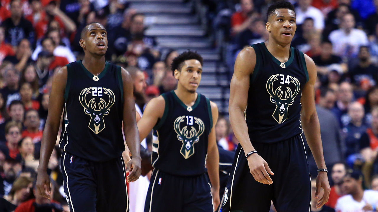TORONTO, ON - APRIL 15: Khris Middleton #22, Malcolm Brogdon #13 and Giannis Antetokounmpo #34 of the Milwaukee Bucks look on in the second half of Game One of the Eastern Conference Quarterfinals against the Toronto Raptors during the 2017 NBA Playoffs at Air Canada Centre on April 15, 2017 in Toronto, Canada.