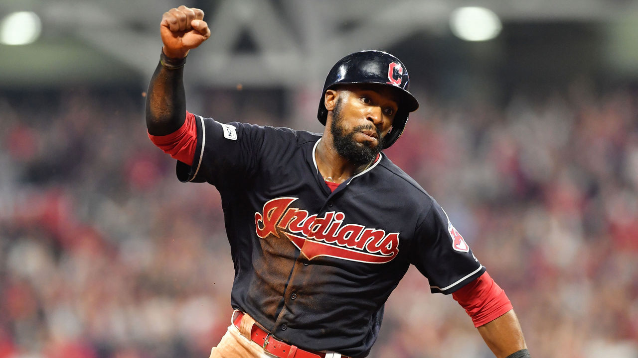 CLEVELAND, OH - OCTOBER 06: Austin Jackson #26 runs home to score the winning run on a single by Yan Gomes #7 of the Cleveland Indians to win the game 9 to 8 in the 13th inning during game two of the American League Division Series at Progressive Field on October 6, 2017 in Cleveland, Ohio.