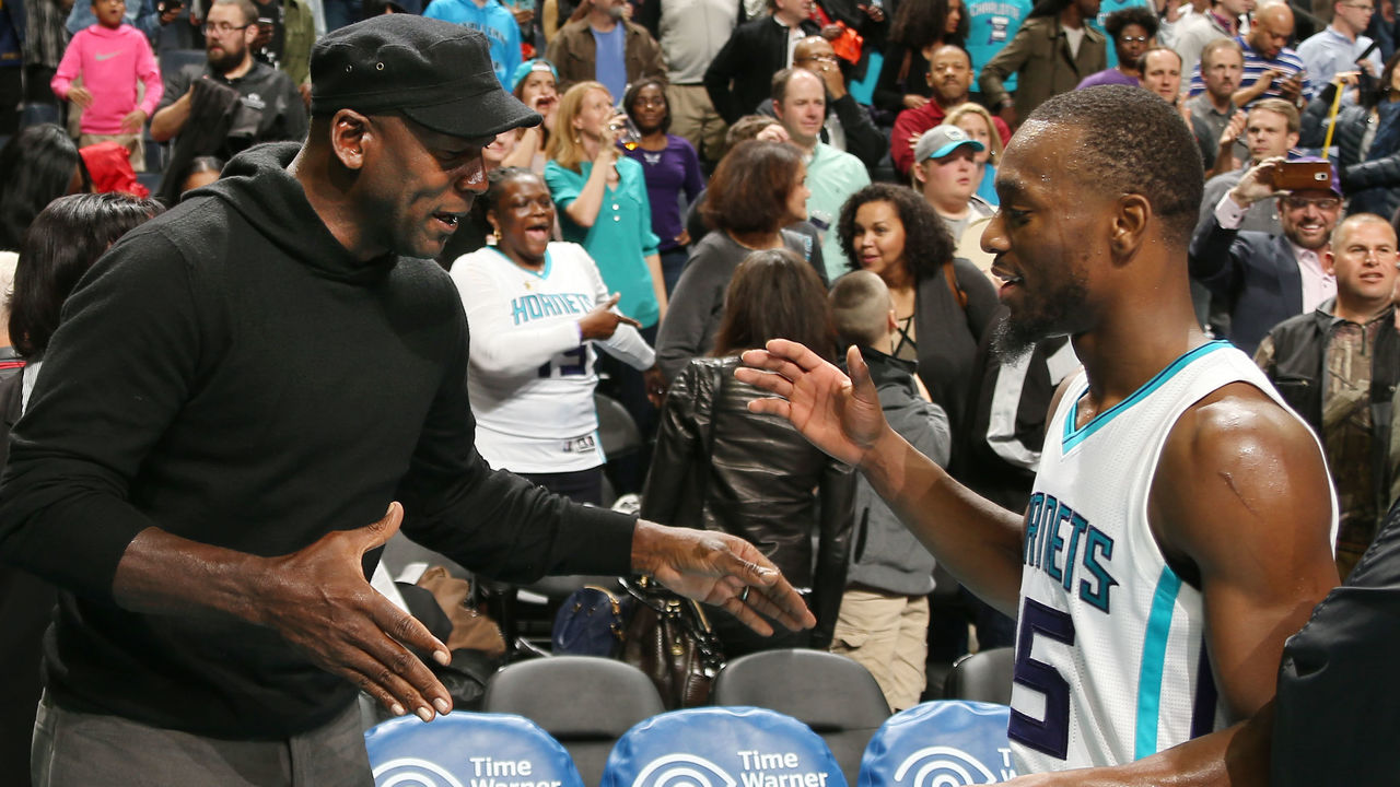 CHARLOTTE, NC - NOVEMBER 25: Hornets owner Michael Jordan high fives Kemba Walker #15 after the game against the Washington Wizards during the game on November 25, 2015 at Time Warner Cable Arena in Charlotte, North Carolina. Mandatory Copyright Notice: Copyright 2015 NBAE