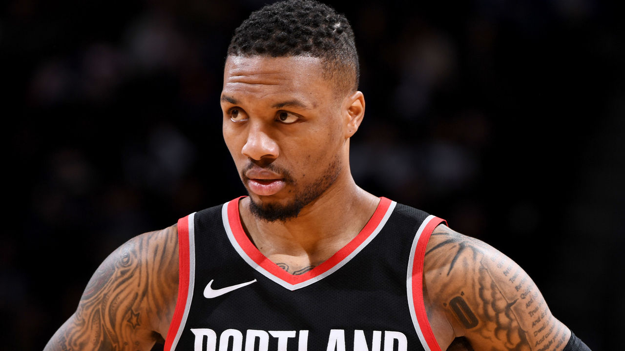 DENVER, CO - JANUARY 22: Damian Lillard #0 of the Portland Trail Blazers looks on during the game against the Denver Nuggets on January 22, 2018 at the Pepsi Center in Denver, Colorado. NOTE TO USER: User expressly acknowledges and agrees that, by downloading and/or using this Photograph, user is consenting to the terms and conditions of the Getty Images License Agreement. Mandatory Copyright Notice: Copyright 2018 NBAE