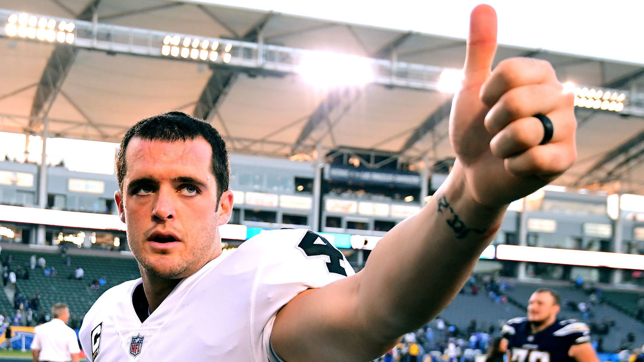 CARSON, CA - DECEMBER 31: Derek Carr #4 of the Oakland Raiders reacts as he leaves the field after 30-10 loss to the Los Angeles Chargers at StubHub Center on December 31, 2017 in Carson, California.