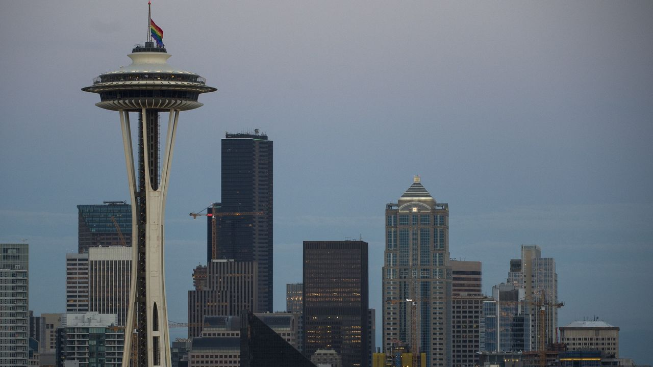 A rainbow flag flies at half mast on the Space Needle in Seattle, Washington on June 12, 2016, in honor of the victims of the nightclub shooting in Orlando. Fifty people died when a gunman allegedly inspired by the Islamic State group opened fire inside a gay nightclub in Florida, in the worst terror attack on US soil since September 11, 2001. / AFP / OMAR TORRES