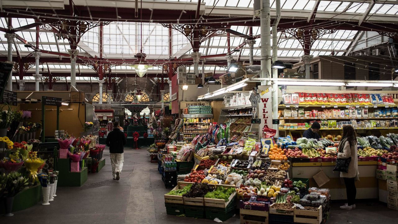 Traders open for business in the Central Market of St Helier, on the British island of Jersey, on November 9, 2017. Jersey is a British Crown Dependency, with a population of 100,000. The EU on has pushed for Europe to draw up a blacklist of tax havens after the 'Paradise Papers' revealed loopholes used by Apple and Nike as well as celebrities such as Formula One champion Lewis Hamilton. / AFP PHOTO / OLI SCARFF