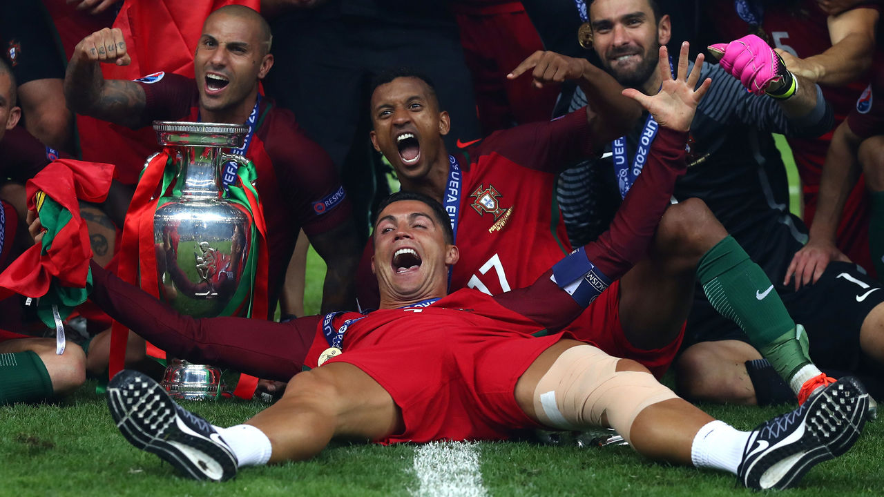 PARIS, FRANCE - JULY 10: Cristiano Ronaldo and Portugal players celebrate after their 1-0 win against France in the UEFA EURO 2016 Final match between Portugal and France at Stade de France on July 10, 2016 in Paris, France.