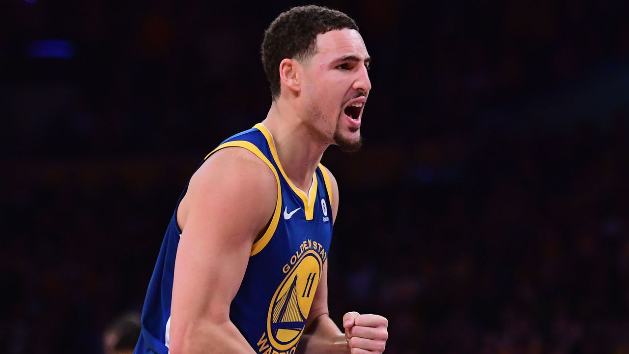 LOS ANGELES, CA - DECEMBER 18: Klay Thompson #11 of the Golden State Warriors celebrates a 116-114 win over the Los Angeles Lakers at the buzzer at Staples Center on December 18, 2017 in Los Angeles, California.