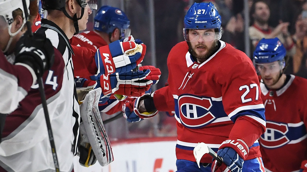 MONTREAL, QC - JANUARY 23: Alex Galchenyuk #27 of the Montreal Canadiens celebrates with the bench after scoring a goal against of the Colorado Avalanche in the NHL game at the Bell Centre on January 23, 2018 in Montreal, Quebec, Canada.