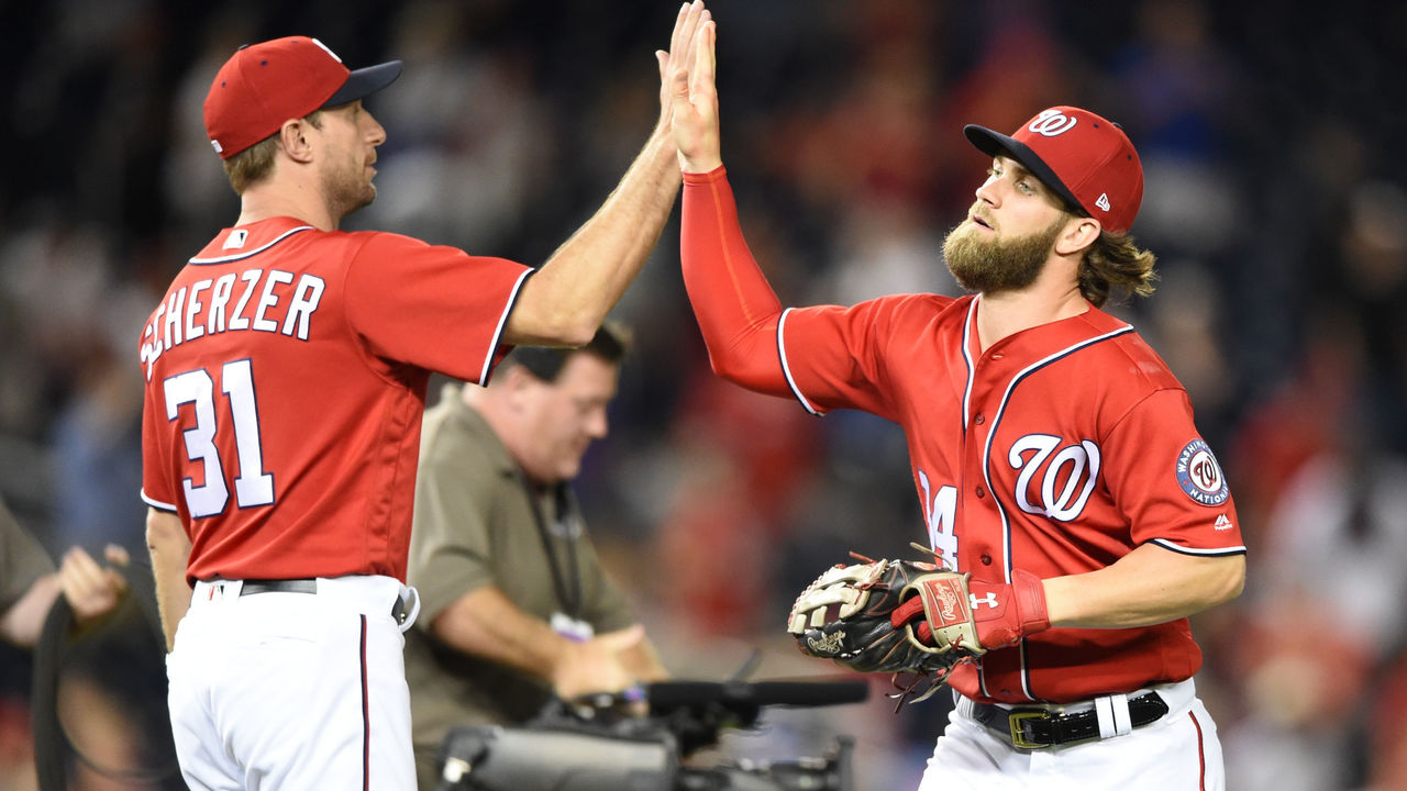 WASHINGTON, DC - JULY 30: Bryce Harper #34 of the Washington Nationals celebrates a win with Max Scherzer #31 after game two of a doubleheader against the Colorado Rockies at Nationals Park on July 30, 2017 in Washington, DC.