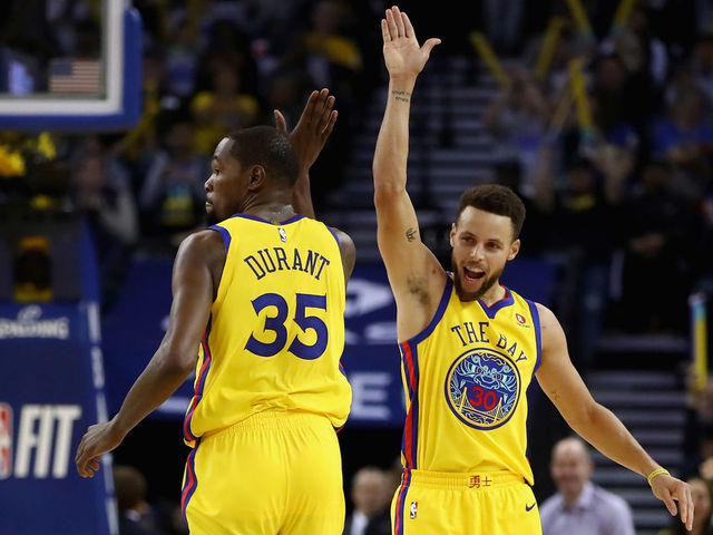 OAKLAND, CA - JANUARY 25: Stephen Curry #30 of the Golden State Warriors congratulates Kevin Durant #35 after he made a basket against the Minnesota Timberwolves at ORACLE Arena on January 25, 2018 in Oakland, California.