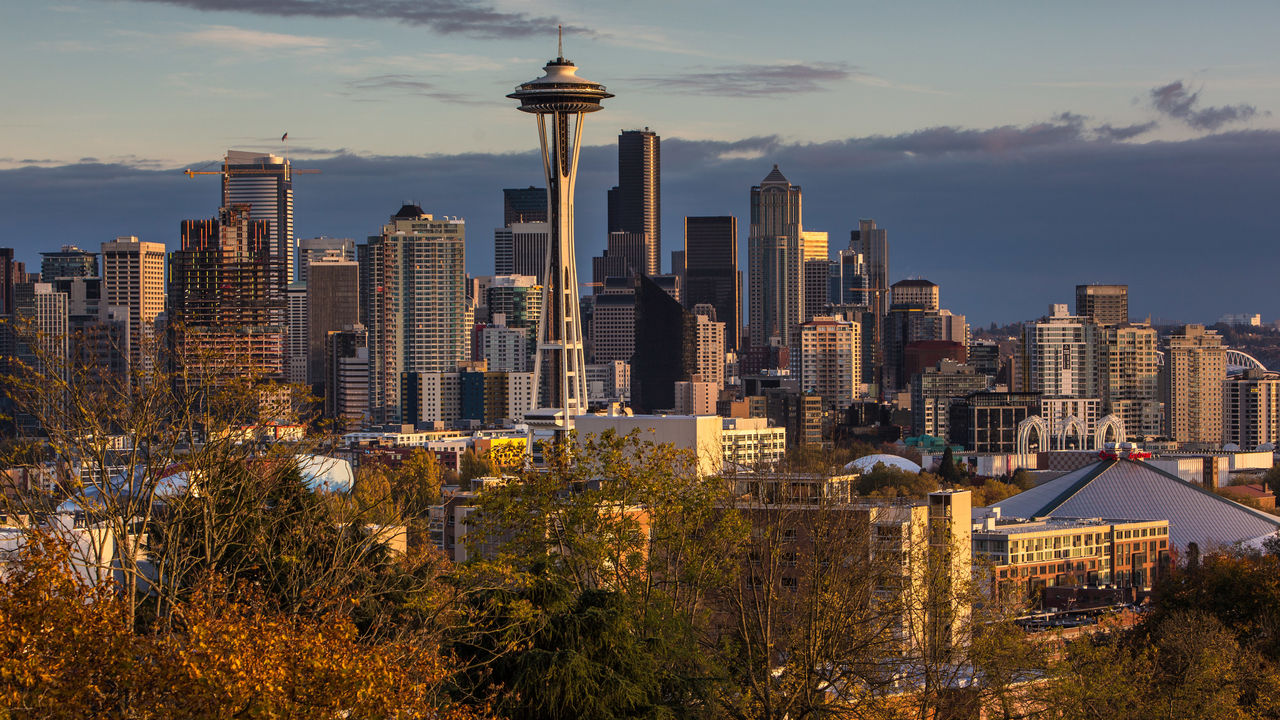 SEATTLE, WA - NOVEMBER 4: The sun sets on the Space Needle and downtown skyline as viewed from Queen Anne Hill on November 4, 2015, in Seattle, Washington. Seattle, located in King County, is the largest city in the Pacific Northwest, and is experiencing an economic boom as a result of its European and Asian global business connections.