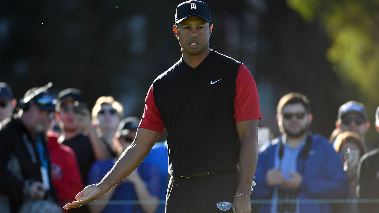 SAN DIEGO, CA - JANUARY 28: Tiger Woods reacts on the 11th green during the final round of the Farmers Insurance Open at Torrey Pines South on January 28, 2018 in San Diego, California.
