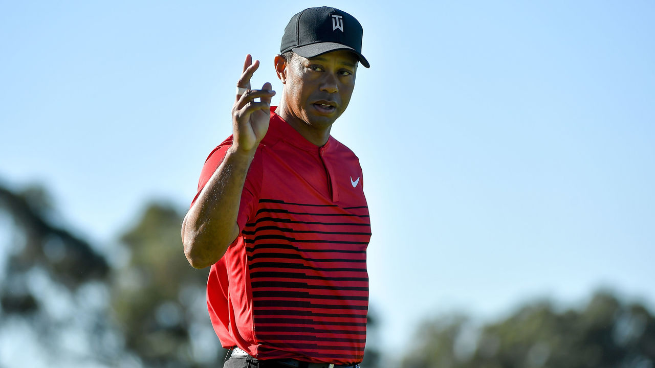 SAN DIEGO, CA - JANUARY 28: Tiger Woods motions to the crowd after a putt on the 14th green during the final round of the Farmers Insurance Open at Torrey Pines South on January 28, 2018 in San Diego, California.