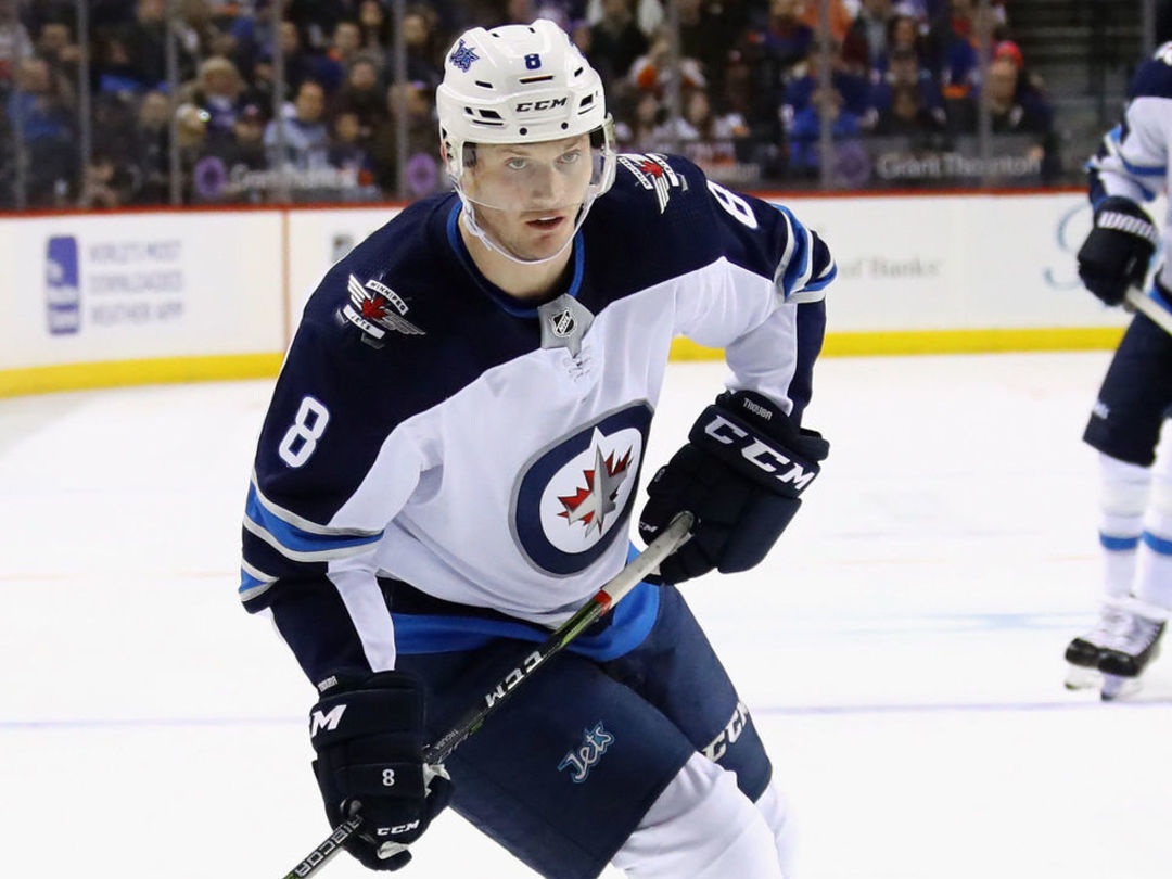 Jets' Trouba forced from game after crushing hit from Benn