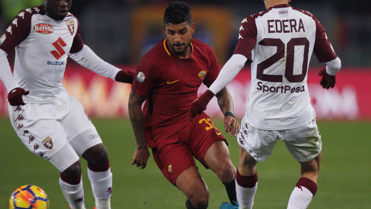 ROME, ITALY - DECEMBER 20: Emerson Palmieri (C) of AS Roma competes for the ball with Simone Edera and Ebenezer Acquah of Torino FC during the TIM Cup match between AS Roma and Torino FC at Olimpico Stadium on December 20, 2017 in Rome, Italy.