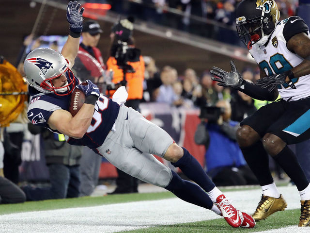 FOXBOROUGH, MA - JANUARY 21: Danny Amendola #80 of the New England Patriots catches a touchdown pass as he is defended by Tashaun Gipson #39 of the Jacksonville Jaguars in the fourth quarter during the AFC Championship Game at Gillette Stadium on January 21, 2018 in Foxborough, Massachusetts.