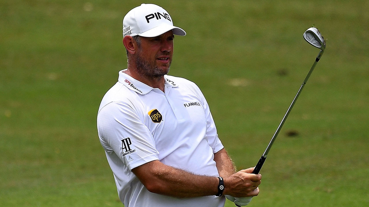 Lee Westwood of England watches his shot on the 9th fairway during the second round of the 2018 Maybank Malaysia Golf Championship at Saujana Golf and Country Club outside Kuala Lumpur on February 2, 2018. / AFP PHOTO / Manan VATSYAYANA