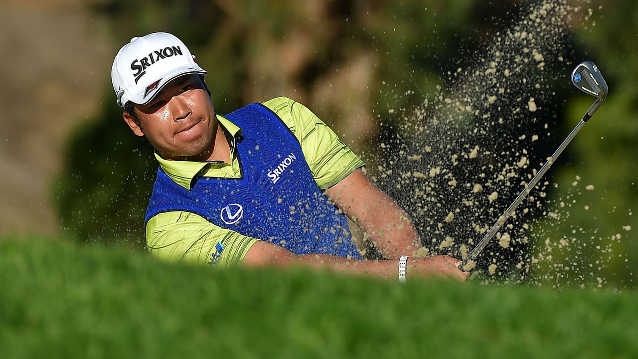 SAN DIEGO, CA - JANUARY 28: Hideki Matsuyama of Japan plays a shot from a bunker on the 13th hole during the final round of the Farmers Insurance Open at Torrey Pines South on January 28, 2018 in San Diego, California.