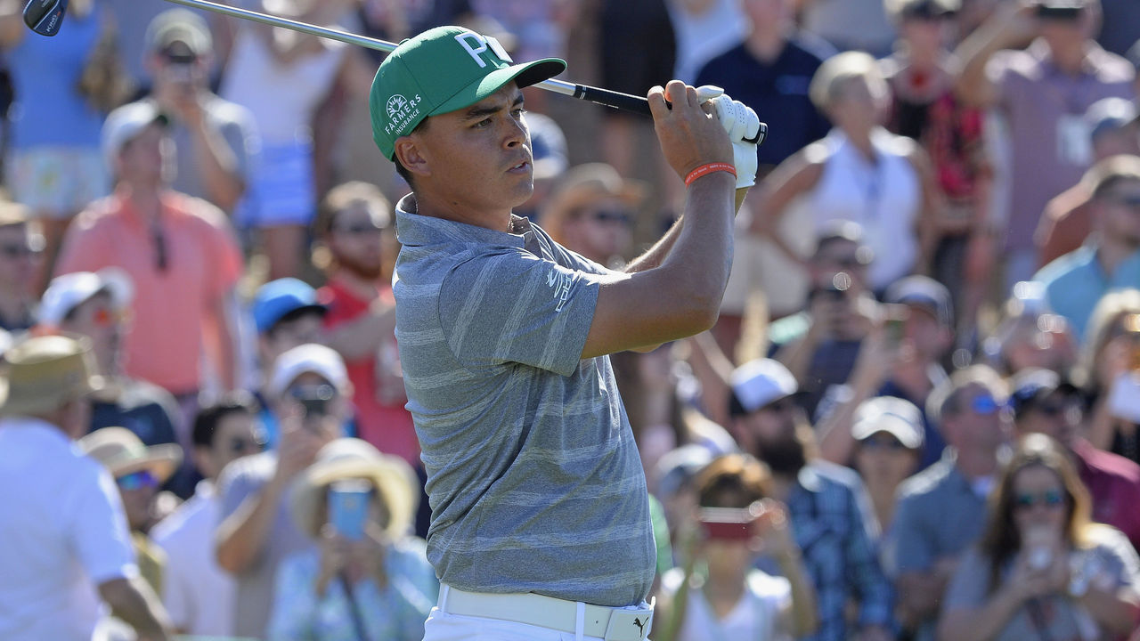 SCOTTSDALE, AZ - FEBRUARY 03: Rickie Fowler watches his tee shot on the eighth hole during the third round of the Waste Management Phoenix Open at TPC Scottsdale on February 3, 2018 in Scottsdale, Arizona.
