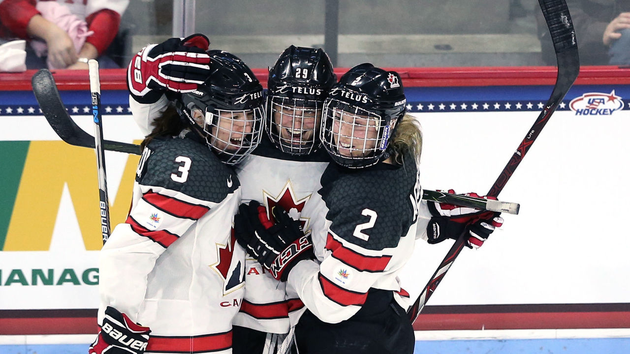 BOSTON, MA - OCTOBER 25: Marie-Philip Poulin #29 of Canada celebrates with Jocelyne Larocque #3 and Meghan Agosta #2 after scoring against the United States during the third period at Agganis Arena at Boston University on October 25, 2017 in Boston, Massachusetts. Canada defeat the United states 5-1.