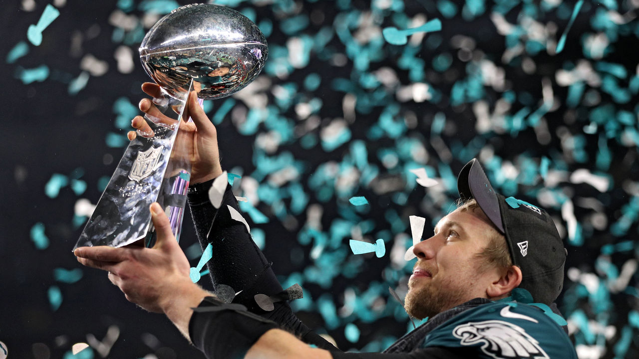 MINNEAPOLIS, MN - FEBRUARY 04: Quarterback Nick Foles #9 of the Philadelphia Eagles raises the Vince Lombardi Trophy after defeating the New England Patriots, 41-33, in Super Bowl LII at U.S. Bank Stadium on February 4, 2018 in Minneapolis, Minnesota.
