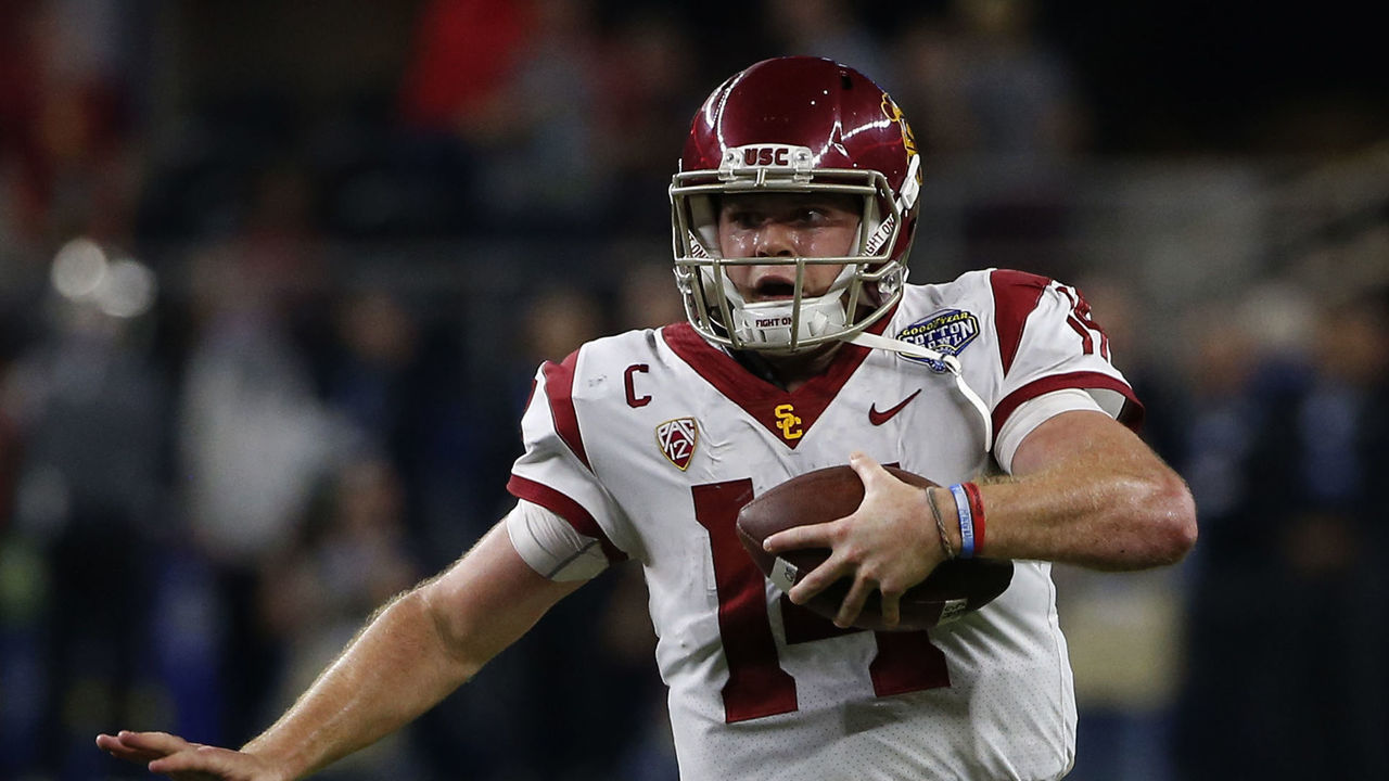ARLINGTON, TX - DECEMBER 29: Sam Darnold #14 of the USC Trojans scrambles against the Ohio State Buckeyes in the second half of the 82nd Goodyear Cotton Bowl Classic between USC and Ohio State at AT&T Stadium on December 29, 2017 in Arlington, Texas. Ohio State won 24-7.