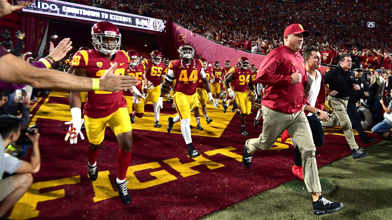 LOS ANGELES, CA - NOVEMBER 18: Head coach Clay Helton of the USC Trojans leads his team on to the field to face the UCLA Bruins at Los Angeles Memorial Coliseum on November 18, 2017 in Los Angeles, California.