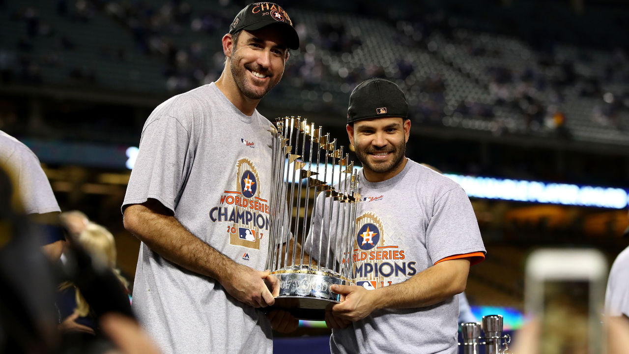 LOS ANGELES, CA - NOVEMBER 01: Justin Verlander #35 and Jose Altuve #27 of the Houston Astros hold the Commissioner's Trophy after defeating the Los Angeles Dodgers 5-1 in game seven to win the 2017 World Series at Dodger Stadium on November 1, 2017 in Los Angeles, California.