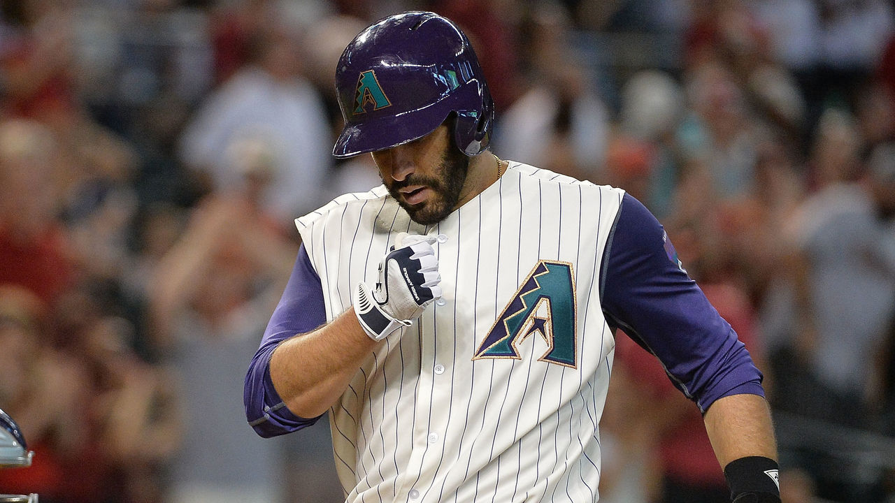 PHOENIX, AZ - SEPTEMBER 14: J.D. Martinez #28 of the Arizona Diamondbacks celebrates hitting a solo home run in the third inning of the MLB game against the Colorado Rockies against at Chase Field on September 14, 2017 in Phoenix, Arizona.