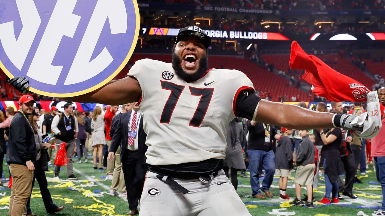 ATLANTA, GA - DECEMBER 02: Isaiah Wynn #77 of the Georgia Bulldogs celebrates beating the Auburn Tigers in the SEC Championship at Mercedes-Benz Stadium on December 2, 2017 in Atlanta, Georgia.
